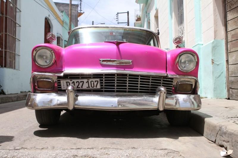 Pink vintage car in Camaguey, Cub